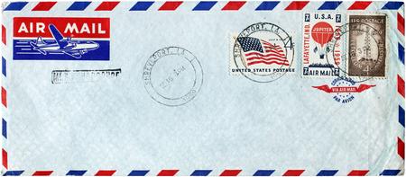 USA - CIRCA 1959: A set of three stamps printed by USA shows Oil Derrick, Jupiter Hot Air Balloon and US Flag, circa 1959.