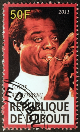 louis armstrong: DJIBOUTI - CIRCA 2011: A postage stamp printed by DJIBOUTI shows image portrait of  famous American jazz trumpeter and singer Louis Armstrong, circa 2011.