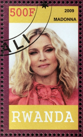 philanthropist: RWANDA - CIRCA 2009: A stamp printed by Rwanda shows famous American singer, songwriter, actress, author, director, entrepreneur and philanthropist Madonna Louise Ciccone, circa 2009 Editorial