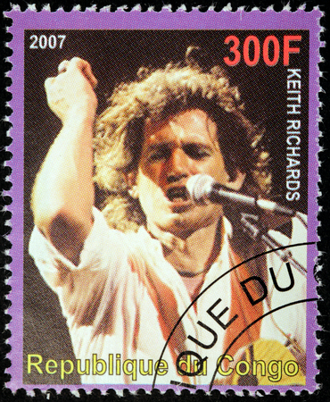 english famous: CONGO - CIRCA 2007: A postage stamp printed by CONGO shows image portrait of  famous English musician, composer, singer and songwriter Keith Richards, circa 2007. Editorial
