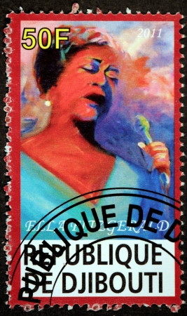 ella: DJIBOUTI - CIRCA 2011: A postage stamp printed by DJIBOUTI shows image portrait of  famous American jazz vocalist with a vocal range spanning three octaves Ella Fitzgerald, circa 2011.