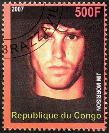 morrison: CONGO - CIRCA 2007: A postage stamp printed by CONGO shows image portrait of  famous American musician, composer, singer, songwriter and  poet  Jim Morrison, circa 2007. Editorial