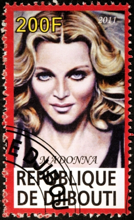 DJIBOUTI - CIRCA 2011: A stamp printed by DJIBOUTI shows famous American singer, songwriter, actress, author, director, entrepreneur and philanthropist Madonna Louise Ciccone, circa 2011 Editorial