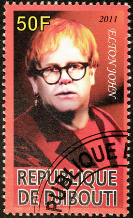 english famous: DJIBOUTI - CIRCA 2011: A stamp printed by DJIBOUTI shows image portrait of famous English singer, songwriter, composer, pianist and record producer Elton John, circa 2011