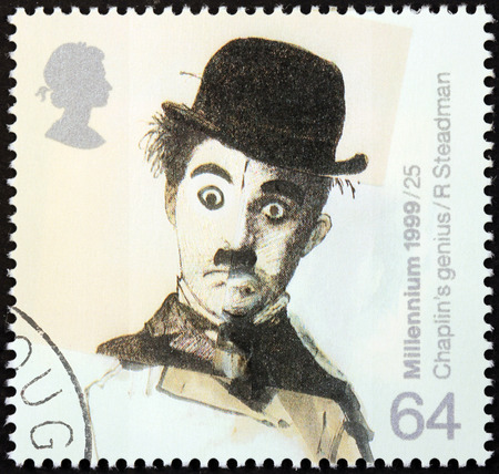 UNITED KINGDOM - CIRCA 1999: a stamp printed by UNITED KINGDOM shows image portrait of famous English comic actor and filmmaker Sir Charles Spencer Charlie Chaplin, circa 1999.