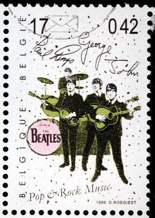 john lennon: BELGIUM - CIRCA 1999: a stamp printed by BELGIUM shows famous British rock band The Beatles, circa 1999