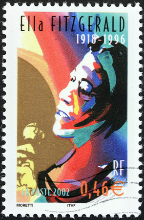 songbook: FRANCE - CIRCA 2002: A stamp printed by FRANCE shows image portrait of  famous American jazz vocalist with a vocal range spanning three octaves Ella Fitzgerald, circa 2002