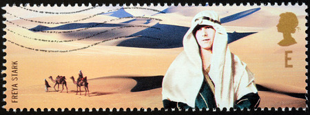 UNITED KINGDOM - CIRCA 2003: a stamp printed by UNITED KINGDOM shows image portrait of British explorer and travel writer Dame Freya Madeline Stark, circa 2003.