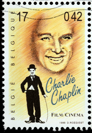 BELGIUM - CIRCA 1999: a stamp printed by BELGIUM shows image portrait of famous British comic actor and filmmaker Sir Charles Spencer Charlie Chaplin, circa 1999. Editöryel