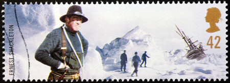 ernest: UNITED KINGDOM - CIRCA 2003: a stamp printed by UNITED KINGDOM shows polar explorer Sir Ernest Henry Shackleton who led three British expeditions to the Antarctic, circa 2003.
