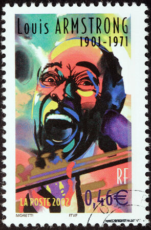louis armstrong: FRANCE - CIRCA 2002: A stamp printed by FRANCE shows image portrait of famous American jazz trumpeter and singer Louis Armstrong, circa 2002