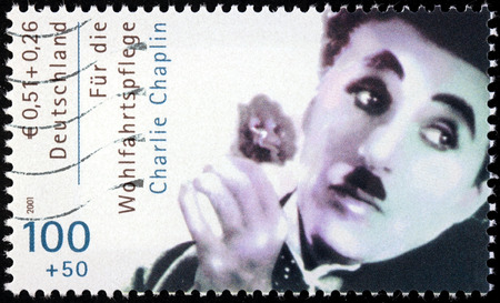GERMANY - CIRCA 2001: A stamp printed by GERMANY shows image portrait of famous English comic actor and filmmaker Sir Charles Spencer Charlie Chaplin, circa 2001