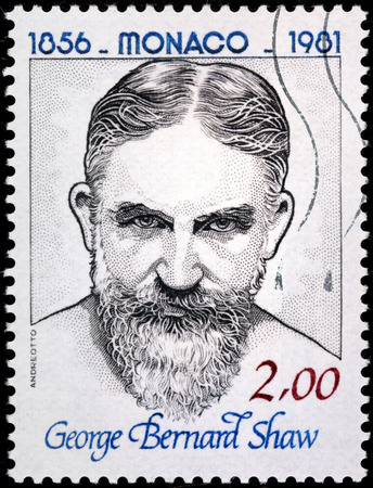 dramatist: MONACO - CIRCA 1981: A stamp printed by MONACO shows image portrait of Irish dramatist, literary critic  and a co-founder of the London School of Economics George Bernard Shaw, circa 1981. Editorial