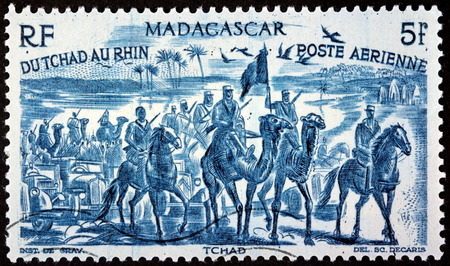 camel post: MADAGASCAR - CIRCA 1946: A postage stamp printed by MADAGASCAR shows Free French Forces in Chad,  West Africa (1940), circa 1946