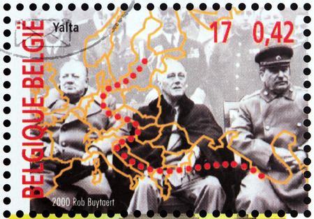 BELGIUM - CIRCA 2000: a stamp printed by BELGIUM shows Yalta (Crimea) Conference in February 1945 with Winston Churchill, Franklin D. Roosevelt and Joseph Stalin (Big Three), circa 2000. Editorial