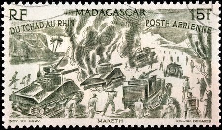 MADAGASCAR - CIRCA 1946: A postage stamp printed by MADAGASCAR shows Free French Forces in action at Mareth Line, Tunisia, North Africa (1943), circa 1946
