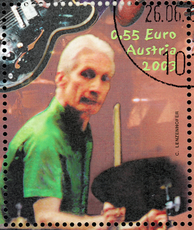 watts: AUSTRIA - CIRCA 2003: A stamp printed by AUSTRIA shows image portrait of  famous English drummer Charles Robert (Charlie) Watts best known as a member of the Rolling Stone, circa 2003.