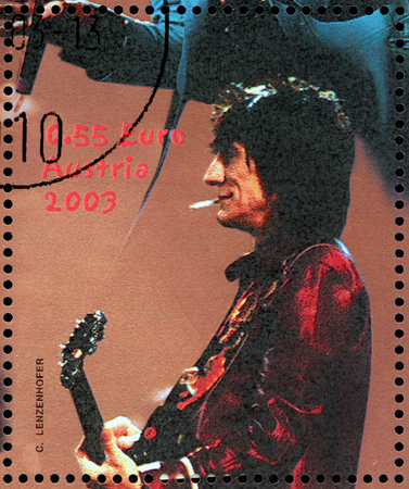 english famous: AUSTRIA - CIRCA 2003: A stamp printed by AUSTRIA shows image portrait of  famous English musician, composer, singer and songwriter Ronald David (Ronnie) Wood, circa 2003.