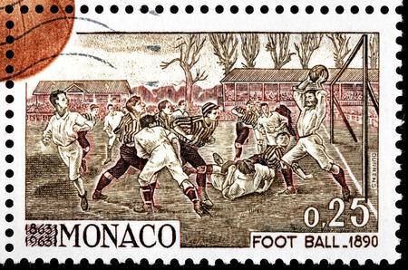 kickball: MONACO - CIRCA 1963: A stamp printed by MONACO shows ancient engraving of Football Match 1890, circa 1963
