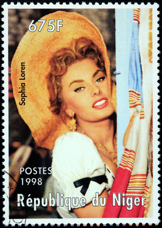 NIGER - CIRCA 1998: A stamp printed by NIGER shows image portrait of famous Italian actress Sophia Loren, circa 1998