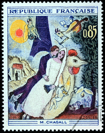chagall: FRANCE - CIRCA 1963: A stamp printed by FRANCE shows engraving after painting Married couple at the Eiffel Tower by Belarussian-Russian-French artist Marc Chagall (1887-1995), circa 1963