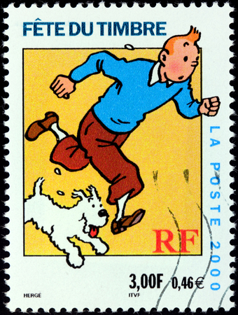 FRANCE - CIRCA 2000: A stamp printed by FRANCE shows image of cartoon character Tintin with his dog Snowy, circa 2000