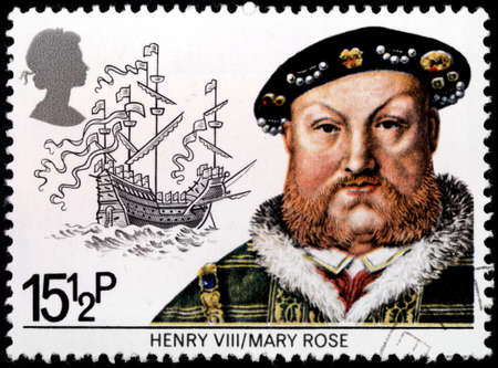 warship: UNITED KINGDOM - CIRCA 1982: A stamp printed by UNITED KINGDOM shows King Henry VIII against Mary Rose - carrack type warship of the English Tudor navy of King Henry VIII, circa 1982 Editorial