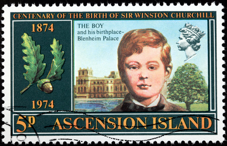 winston: ASCENSION ISLAND - CIRCA 1974: A stamp printed by GREAT BRITAIN shows image portrait of young Winston Churchill against his birthplace - Blenheim Palace (Woodstock, Oxfordshire, England), circa 1974