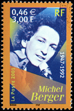 berger: FRANCE - CIRCA 2001: A stamp printed by FRANCE shows image portrait of famous French pop singer and songwriter Michel Berger, circa 2001 Editorial