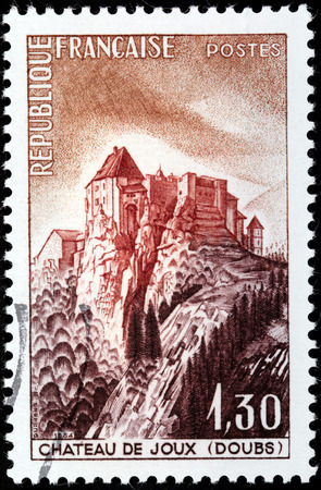 FRANCE - CIRCA 1964: A stamp printed by FRANCE shows view of Fort de Joux (Chateau de Joux) - castle located in La Cluse-et-Mijoux, in the Doubs departement, in Jura mountains of France, circa 1964