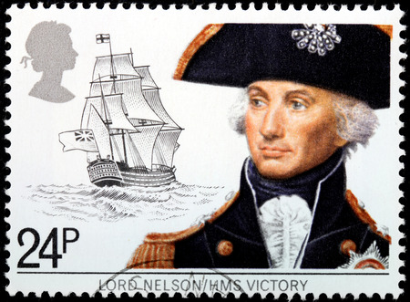 flagship: UNITED KINGDOM - CIRCA 1982: A stamp printed by UNITED KINGDOM shows image portrait of Vice-Admiral Horatio Nelson against HMS Victory, Lord Nelsons flagship at the Battle of Trafalgar, circa 1982