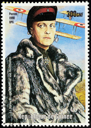 baron: GUINEA - CIRCA 1998: a postage stamp printed by Guinea shows image portrait of Manfred von Richthofen, also known as the Red Baron - famous German fighter pilot during World War I, circa 1998.