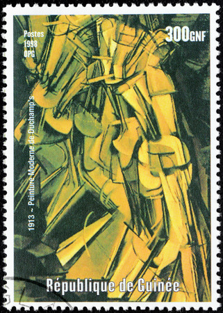 GUINEA - CIRCA 1998: A postage stamp printed by GUINEA shows painting  Nude Descending a Staircase, No. 2 by French-American painter, sculptor, chess player, and writer Marcel Duchamp, circa 1998.