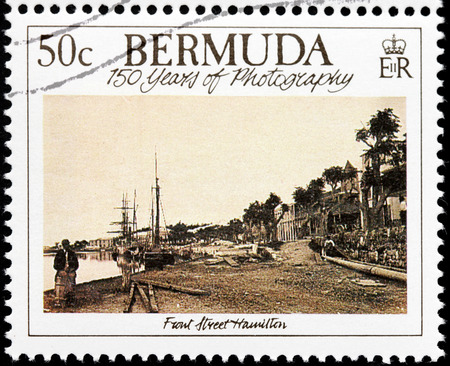 BERMUDA - CIRCA 1989: A stamp printed by GREAT BRITAIN shows old photograph of Front Street in Hamilton. Hamilton is capital city of the Bermudas, circa 1989