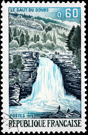 FRANCE - CIRCA 1973: A stamp printed by FRANCE shows beautiful view of The Doubs river in eastern France. Waterfall Le Saut du Doubs, circa 1973