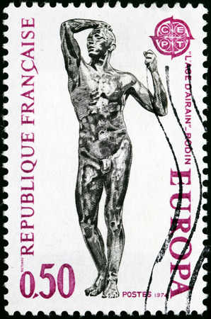 rodin: FRANCE - CIRCA 1974: A stamp printed by FRANCE shows a picture of the Sculpture Age of Bronze (LAge dAirain) by the famous French sculptor Auguste Rodin, circa 1974.