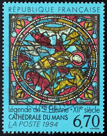 martyrdom: FRANCE - CIRCA 1994: A stamp printed by FRANCE shows Martyrdom of Saint Stephen - Stained Glass Window, Saint  Julianss Cathedral Le Mans (1180), circa 1994