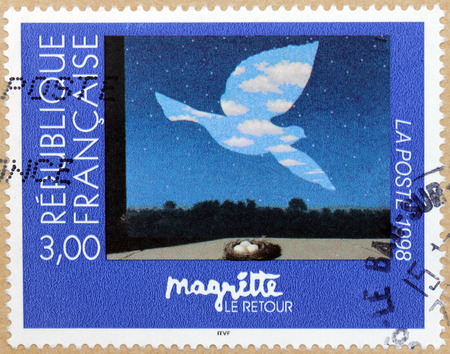 surrealist: FRANCE - CIRCA 1998: A stamp printed by FRANCE shows painting The Return (Le Retour) by famous Belgian surrealist artist Rene Magritte (1898-1967), circa 1998
