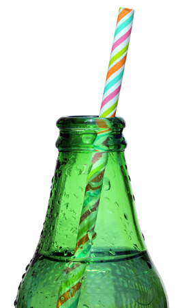 drinking straw:  Glass Bottle of Cider with color striped straw isolated on a white background. Stock Photo