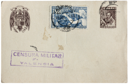 SPAIN - CIRCA 1939: a set of two stamps printed by SPAIN shows Spanish soldiers and image portrait of Miguel de Cervantes Saavedra. Postcard censored by Spanish Military censorship, circa 1939.