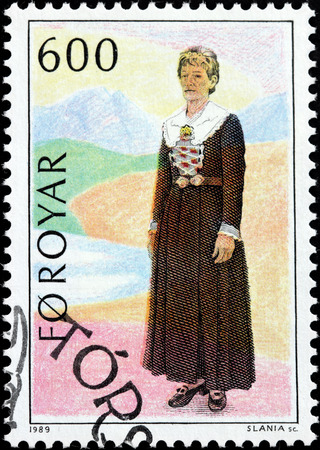 FAROE ISLANDS - CIRCA 1989: A stamp printed by FAROE ISLANDS shows image of womans dress from Stakkur. Faeroese festival dress used at weddings. circa 1989.