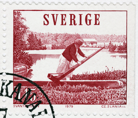 canal lock: SWEDEN - CIRCA 1979: A stamp printed by SWEDEN shows idyllic view of the Gota Canal. Lock Guard from Riksberg Locks, circa 1979