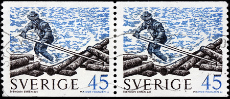 lumberman: SWEDEN - CIRCA 1970: A set of two stamps printed by SWEDEN shows a lumberman in northern Sweden, circa 1970.