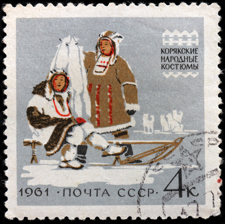 USSR - CIRCA 1961: A stamp printed by USSR (Russia) shows Koryaks couple in traditional dress, circa 1961 Editorial
