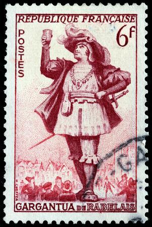 french renaissance: FRANCIA - CIRCA 1953: Un sello impreso por Francia muestra Gargantua, el personaje literario creado por el escritor franc�s Francois Rabelais renacimiento, circa 1953 Editorial