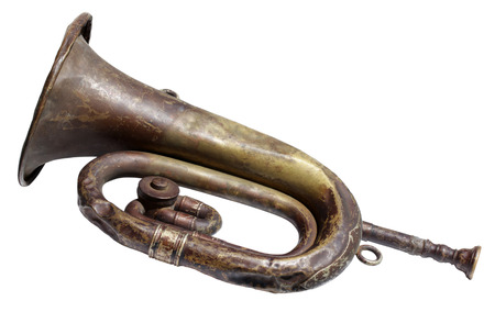 reveille: Very old and rusty bugle isolated on a white background