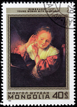 dutch girl: MONGOLIA - CIRCA 1981: A stamp printed by MONGOLIA shows painting Young Girl With Earrings by Dutch painter and etcher Rembrandt van Rijn, circa 1981. Editorial