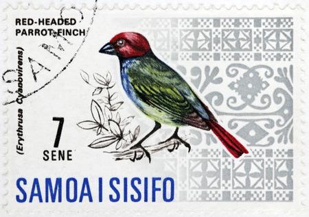 WESTERN SAMOA - CIRCA 1967: A stamp printed by WESTERN SAMOA shows Red-headed Parrotfinch (Erythrura cyaneovirens) - a common species of estrildid finch found in Samoan Islands, circa 1967.