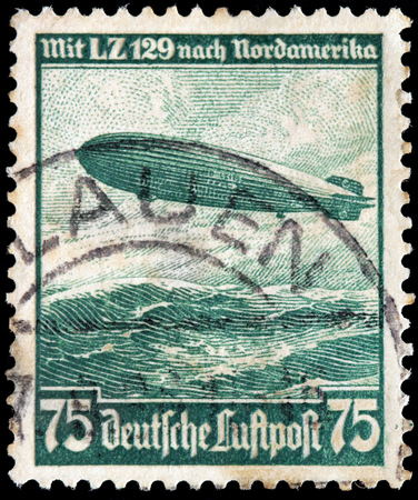 GERMANY - CIRCA 1936: A stamp printed by GERMANY shows  a large German commercial passenger-carrying rigid airship LZ 129 Hindenburg (Luftschiff Zeppelin), circa 1936