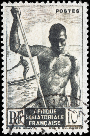 boatman: FRENCH EQUATORIAL AFRICA - CIRCA 1947: A stamp printed by FRANCE shows Boatman and African Pirogue, circa 1947